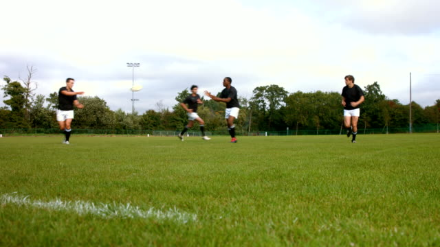 Rugby team members passing the ball video