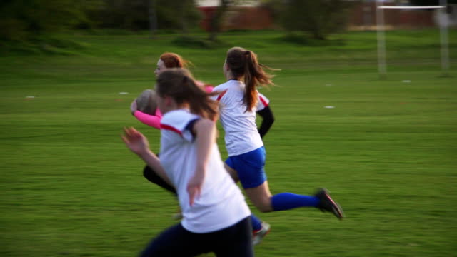 Rugby Teens Chasing a Player with the Ball A group of teen girls playing rugby on the field with their competitive friends, chasing the main player with the ball! rugby stock videos & royalty-free footage