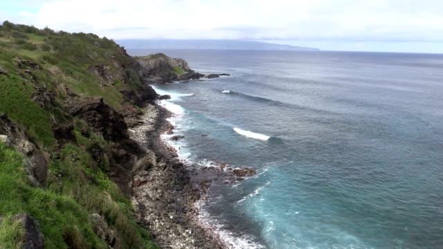 Rugged Scenic Maui Coast waves crash ashore along the rugged coast of Maui Hawaii oceania stock videos & royalty-free footage