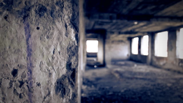 ruined brick wall in old abandoned building. - deterioramento video stock e b–roll