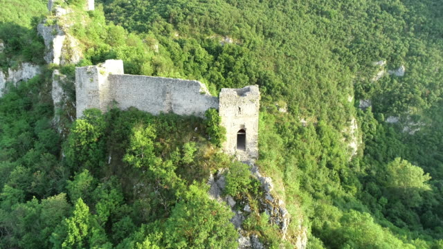 Ruined medieval castle on top of the hill Old ruined fortress of Soko grad  from drone point of view old ruin stock videos & royalty-free footage