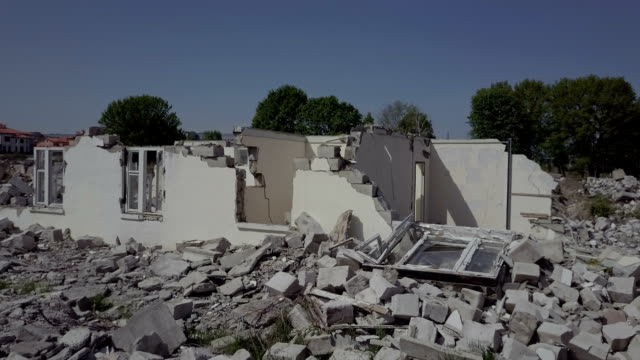 Ruins of a small white house located in the village video