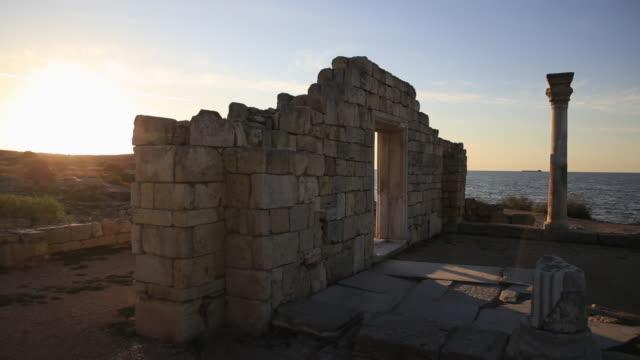 Ruins of Chersonesus basilica, ancient Greek town near modern Sevastopol. Autumn sunset. UNESCO World Heritage Site. Crimea, Russia.