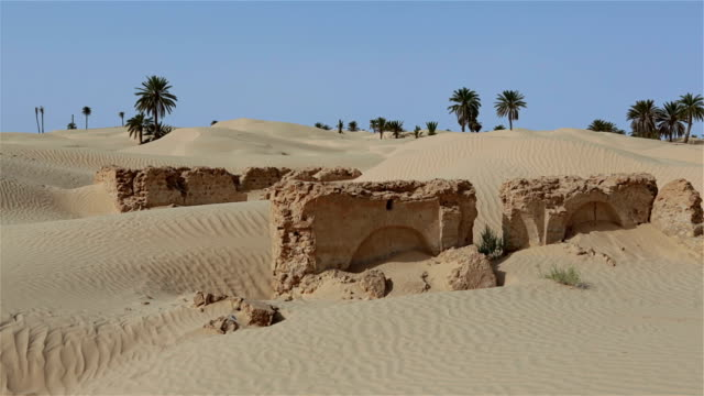 Ruins of Zaafrane a village swallowed up by the sands video