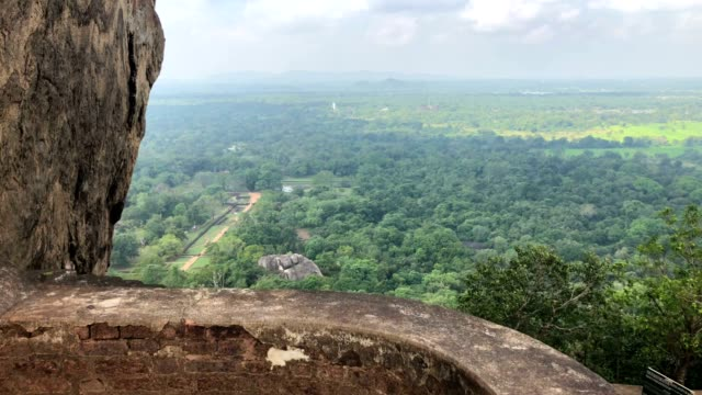 Ruins on top of Sigiriya Lion's rock palace Ruins on top of Sigiriya Lion's rock palace The name refers to a site of historical and archaeological significance that is dominated by a massive column of rock sri lankan culture stock videos & royalty-free footage