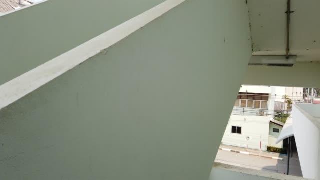 Run down the stairs, fire escape.Human eye view