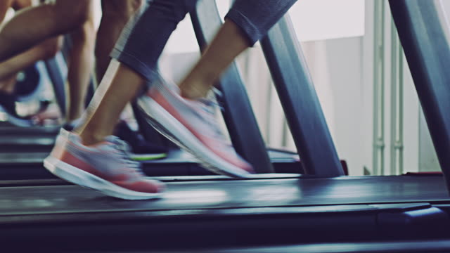 Run towards your fitness goals Close-up 4k video of people working out on a treadmill at the gym healthy lifestyle stock videos & royalty-free footage