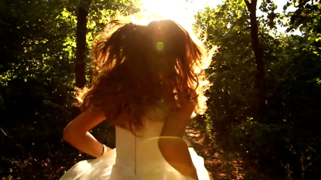 runaway bride concept running in forest hd - wedding fashion stock videos and b-roll footage
