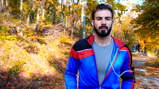 Runner in the park on cold autumn day video
