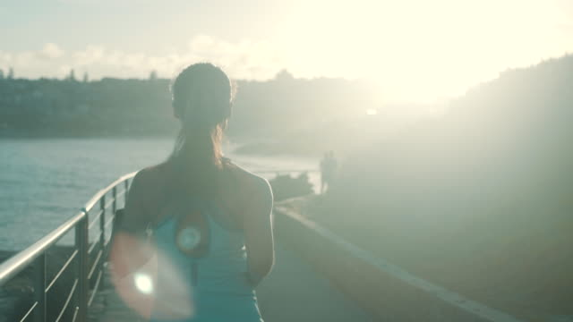 Runner in the sunset (slow motion) Running at Bondi Beach, Sydney healthy lifestyle stock videos & royalty-free footage