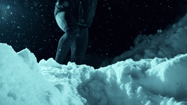 SLO MO Runner jumping over pile of snow at night video