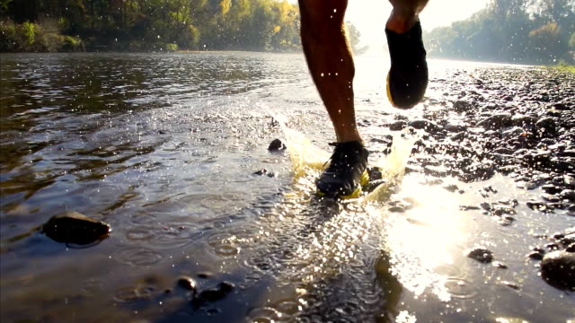 HD SUPER SLOW-MO: Runner Splashing In The River video