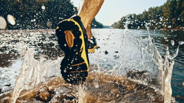 SLO MO Runner splashing in the river video