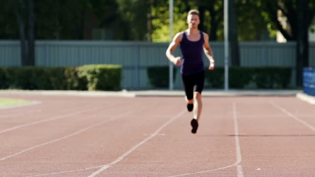 Runner training endurance to overcome short and long distances, slow-motion video