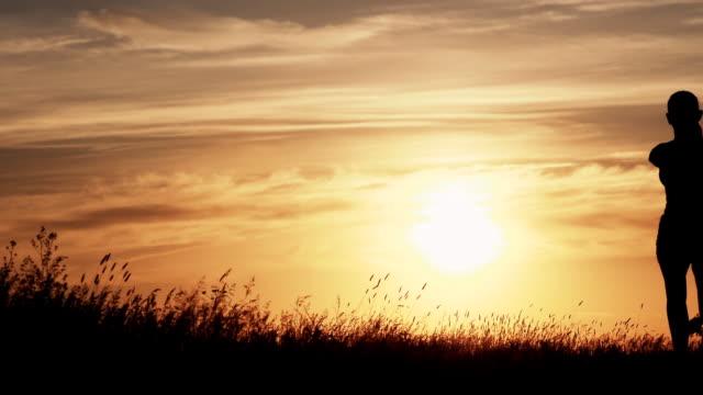 Runner woman running at sunset video