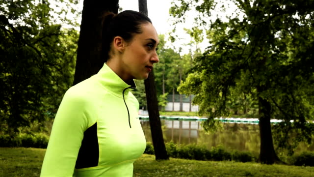 Runner woman running in park video