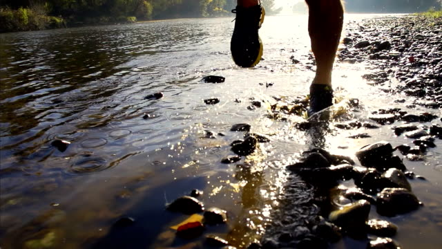 HD SUPER SLOW-MO: Runner's Footwear Splashing Water video