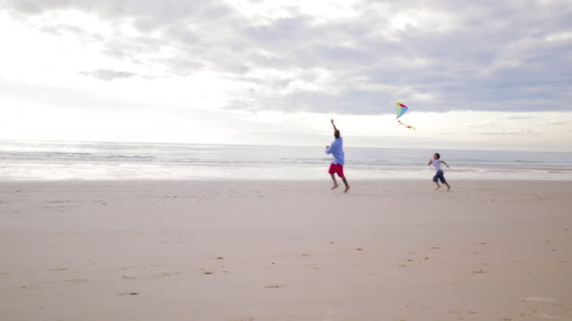 running after a kite - padre single video stock e b–roll