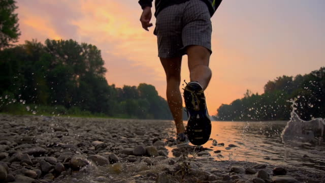 hd super slow-mo: running along the river - active lifestyle stock videos and b-roll footage