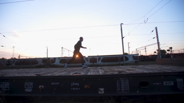 Running and jumping on a train vagons Athlete, exercise on a abandoned old plane, running on railroad. conquering adversity stock videos & royalty-free footage