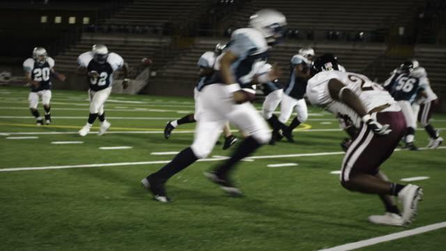 Running back dodges defender - time remapped