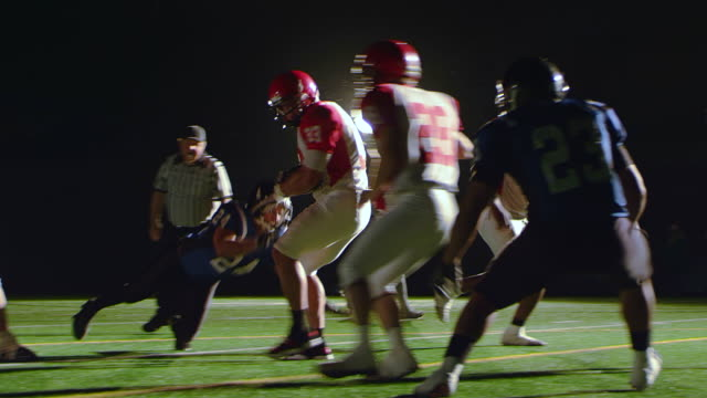 Running back gets tackled as he enters the end zone -Uberstock- HD 1080p-  A running back gets tackled as he enteres and end zone for a touchdown.  Medium shot. This clip was shot on a RED Digital Cinema Camera.[url=http://www.istockphoto.com/file_search.php?action=file&lightboxID=12947611][img]http://www.uberstock.com/uberstock/istock/banners/uberstock_04.gif[/img][/url][url=http://www.istockphoto.com/file_search.php?action=file&lightboxID=LIGHTBOXID][img]http://uberstock.com/uberstock/images/uberstock_02.gif[/img][/url][url=http://www.istockphoto.com/file_search.php?action=file&lightboxID=7415358][img]http://www.uberstock.com/uberstock/istock/banners/Football.jpg[/img][/url] touchdown stock videos & royalty-free footage