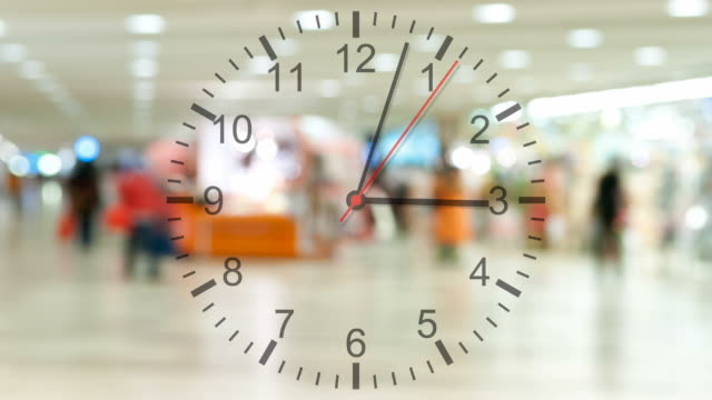 Running clock with pedestrian traffic video
