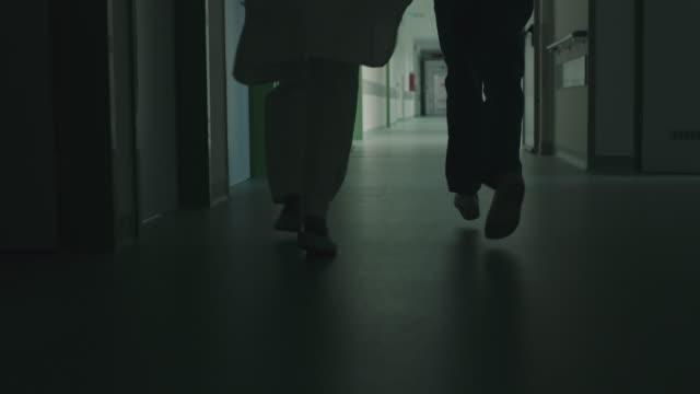 Running legs in hospital corridor