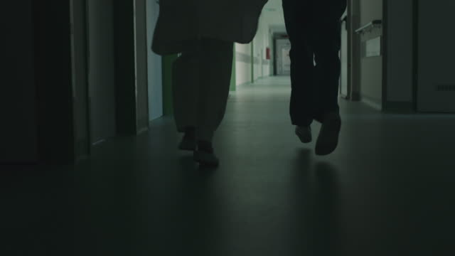 Running legs in hospital corridor video