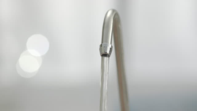 Running tap in Kitchen. Studio Shot, Professional Lighting, Shallow DOF. CU of a Running tap in Kitchen. running water stock videos & royalty-free footage
