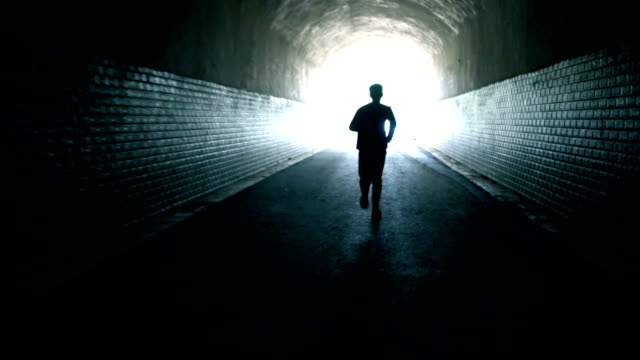 running to the light - tunnel video stock e b–roll