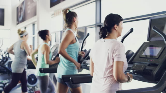 Running towards great results 4k video of people working out on a treadmill at the gym midday stock videos & royalty-free footage