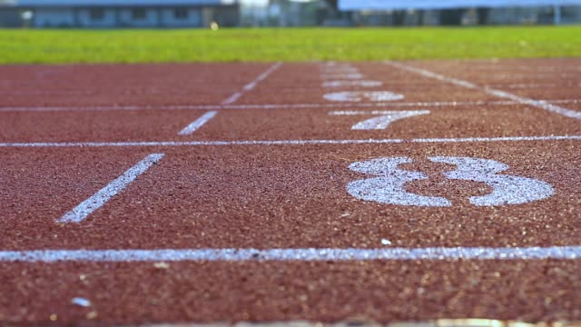 vídeos y material grabado en eventos de stock de pista de atletismo - meta