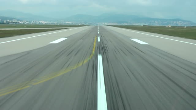 Runway, airstrip in the airport terminal with marking on blue sky with clouds background Runway, airstrip in the airport terminal with marking on blue sky with clouds background stationary stock videos & royalty-free footage