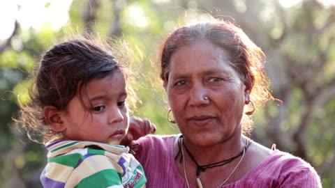 vídeos de stock e filmes b-roll de rural asian little boy with his grandmother in outdoor. - aldeia