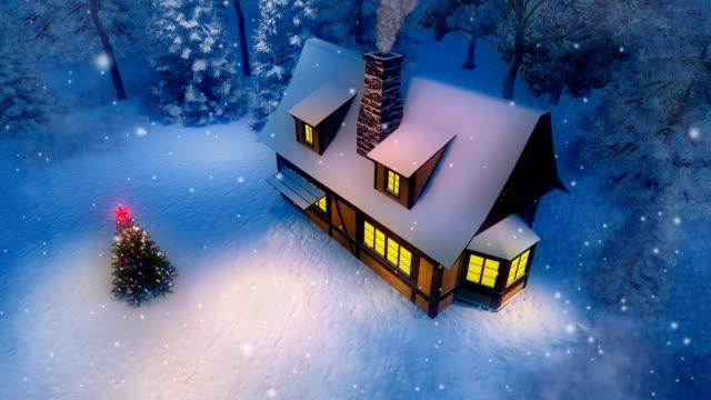 stockvideo's en b-roll-footage met landelijke cabine en kerstboom op besneeuwde winternacht luchtfoto bekijken cinemagraph - christmas cabin