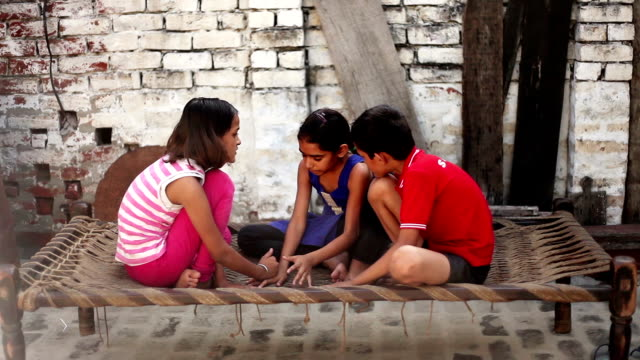 Rural children playing video