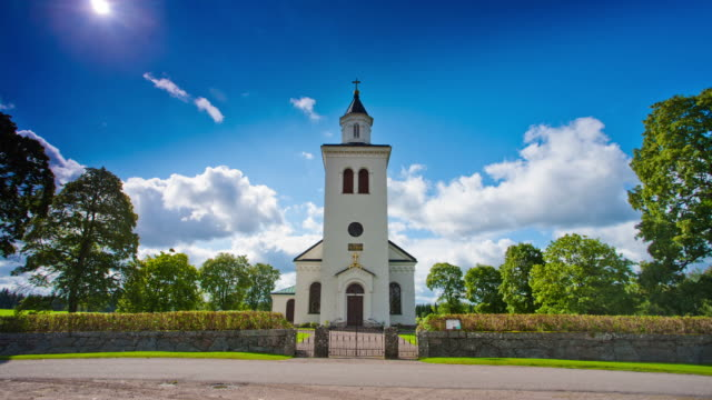 time lapse: rural church in sweden - church architecture stock videos & royalty-free footage