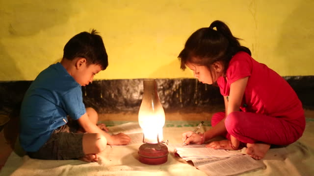 Rural girl and boy studying in lantern video