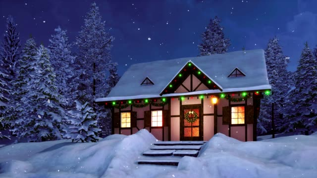 Rural house decorated for Christmas at snowy winter night