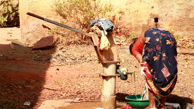 Rural Indian woman washing clothes video