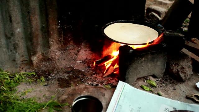Rural traditional Indian women preparing food