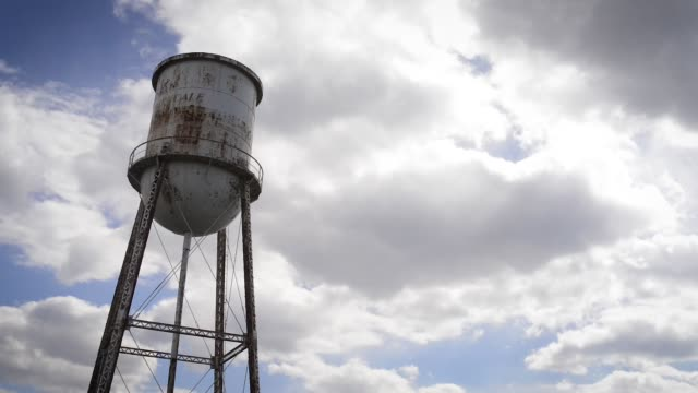 Rural Water Tower (Time Lapse) An old, weathered water tower, just outside of Belmont, NC. americana stock videos & royalty-free footage