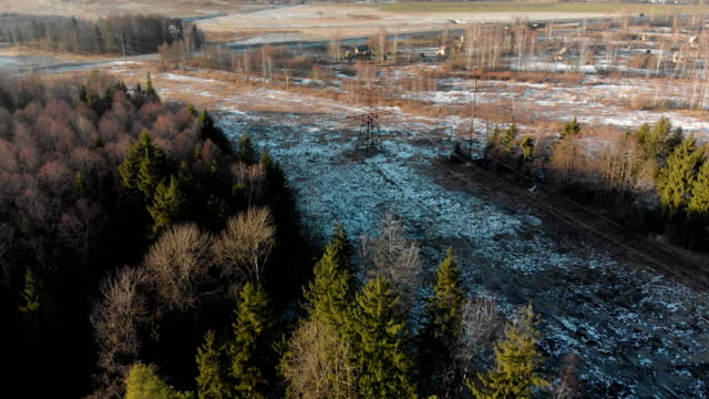 Rural, winter landscape with a village in Siberia, top view. A place for links A drone flying over an overpass, a forest and a Siberian village in the distance, a winter landscape over a plain where settlers live siberia stock videos & royalty-free footage