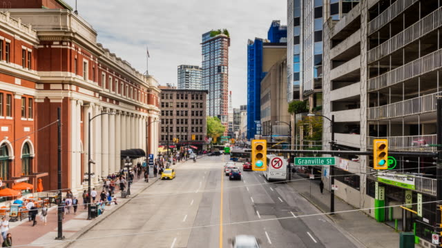 rush hour traffic downtown vancouver - canada travel stock videos and b-roll footage
