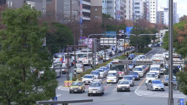 福岡、日本のラッシュアワーの交通渋滞 - 渋滞点の映像素材/bロール