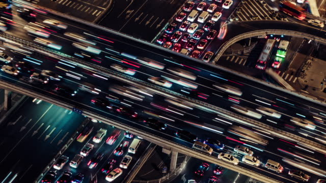 vídeos de stock e filmes b-roll de t/l ha pan rush hour traffic on multiple highways at night / beijing, china - evolução