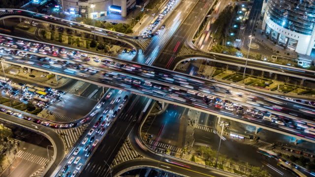 vídeos de stock e filmes b-roll de t/l ws ha zo rush hour traffic on multiple highways at night / beijing, china - evolução