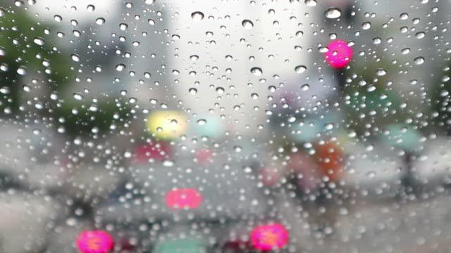 Rush hour with raindrops - Cars stuck in traffic jam in Bangkok Thailand