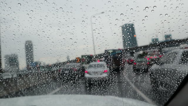 Rush hour with raindrops - Cars stuck on expressway in Bangkok Thailand